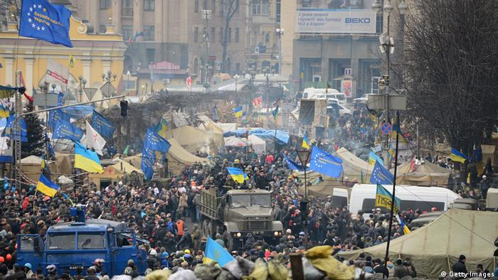 People with Ukraine flags in Independence Square, or Maidan. (Photo: Jeff J Mitchell/Getty Images)