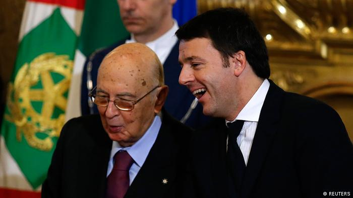 Newly appointed Italian Prime Minister Matteo Renzi (R) talks with Italian President Giorgio Napolitano during the swearing in ceremony for 16 new ministers at Quirinale palace in Rome February 22, 2014. REUTERS/Remo Casilli