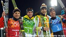 From left : Silver medalists Germany's Erik Lesser, Daniel Boehm, Arnd Peiffer and Simon Schempp celebrate their win in the Men's Biathlon 4x7.5 km Relay at the Laura Cross-Country Ski and Biathlon Center during the Sochi Winter Olympics on February 22, 2014, in Rosa Khutor, near Sochi. AFP PHOTO / ALBERTO PIZZOLI (Photo credit should read ALBERTO PIZZOLI/AFP/Getty Images)