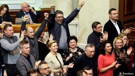 Ukrainian members of parliament cheer at the sitting on 22 February 2014
