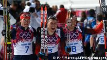 Silver medalist Russia's Maxim Vylegzhanin (7) gold medalist Russia's Alexander Legkov (3) and Bronze medalist Russia's Ilia Chernousov (8) celebrate at the finish line in the Men's Cross-Country Skiing 50km Mass Start Free at the Laura Cross-Country Ski and Biathlon Center during the Sochi Winter Olympics on February 23, 2014, in Rosa Khutor, near Sochi. AFP PHOTO / PIERRE-PHILIPPE MARCOU (Photo credit should read PIERRE-PHILIPPE MARCOU/AFP/Getty Images)