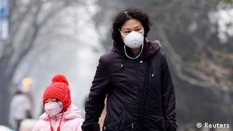 A woman and child wear masks in Beijing
