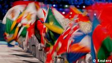Various national flags are seen during the closing ceremony for the 2014 Sochi Winter Olympics, February 23, 2014. REUTERS/Phil Noble (RUSSIA - Tags: OLYMPICS SPORT)