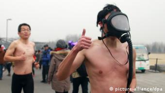 Chinese joggers with gas masks