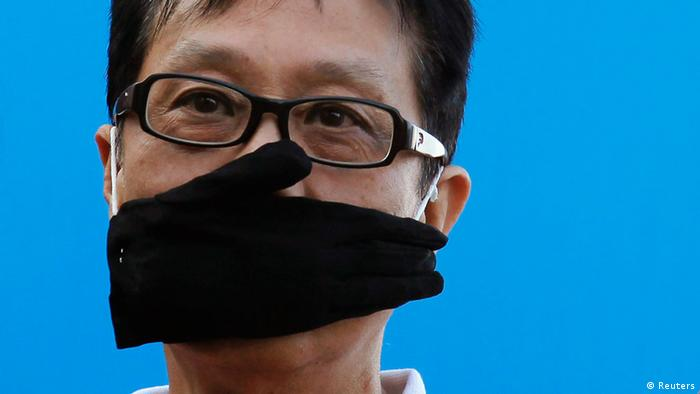 A journalist in Hong Kong protests against curbs on press freedom