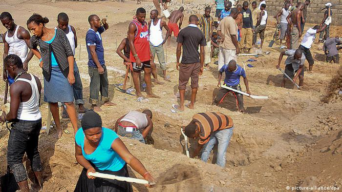 Christians dig graves for their relatives, victims of a bomb attack in Nigeria.
