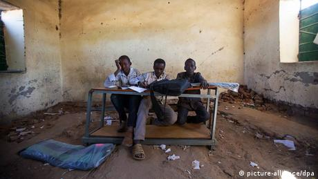 Children sit in a re-opened school in Darfur.