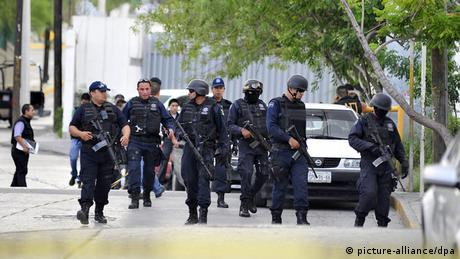 Heavily-armed policemen control the streets of Acapulco.