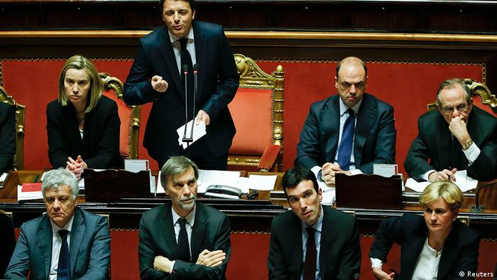 Italy's Prime Minister Matteo Renzi (top 2nd L) speaks during a confidence vote at the Senate in Rome February 24, 2014. Renzi faces his first test before a fractious national parliament on Monday when he goes to the Senate to put flesh on ambitious reform plans and seeks to win a confidence vote in his newly installed government. REUTERS/Tony Gentile