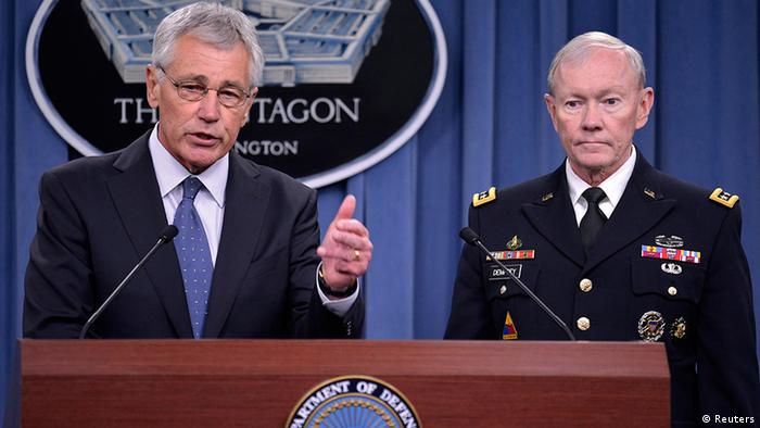Chuck Hagel raises his finger emphasize a point while speaking during a White House press conference.