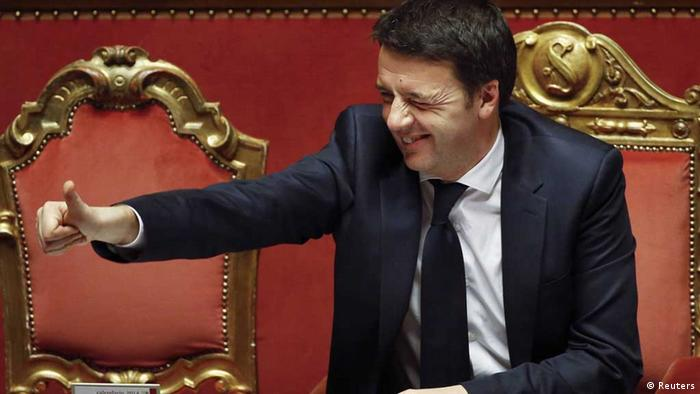 Italy's Prime Minister Matteo Renzi gives the thumb up during a confidence vote at the Senate in Rome February 24, 2014. Renzi, approaching a confidence vote in his new government on Monday, pledged to cut labour taxes, free up funds for investment in schools and pass wide institutional reforms to tackle Italy's economic malaise. REUTERS/Remo Casilli