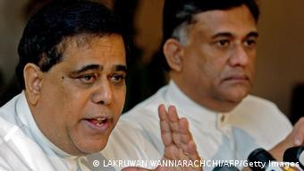 Sri Lankan government delegate Nimal Siripala de Silva, (L) and member of the peace delegation of the Sri Lanka's government, Rohitha Bogollagama, (R) address a press conference in Colombo, 31 October 2006.