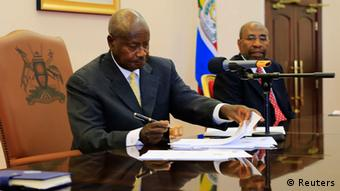 Ugandan President Yoweri Museveni signing the3 anti-gay legislation