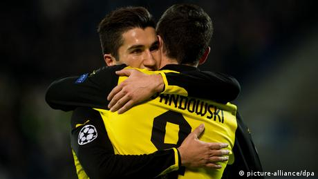Nuri Sahin hugs Dortmund player