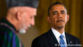 US President Barack Obama (R) and President Hamid Karzai (L) of Afghanistan hold a press conference in the East Room of the White House in Washington DC, USA, 11 January 2013.