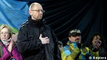Former economy minister Arseny Yatseniuk (front) stands on the stage during a rally in Independence Square in Kiev, February 26, 2014. Ukraine's protest leaders on Wednesday named Yatseniuk as their choice to head a new government following the overthrow of President Viktor Yanukovich. The 'Euromaidan' council made its announcement of Yatseniuk, plus candidates for several other key ministers, after its members addressed crowds on Kiev's Independence Square. REUTERS/Konstantin Chernichkin (UKRAINE - Tags: POLITICS CIVIL UNREST)