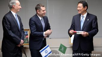Israeli embassy's Deputy Chief of Mission Peleg Lewi (C) and Jewish community of Japan president Philip Rosenfeld (L) smile with Ryo Tanaka (R) Mayor of Suginami ward during a ceremony to donate 300 copies of Anne Frank's 'Diary of a Young Girl' in Tokyo on February 27, 2014.