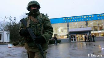 Unidentified armed men took control of two airports in Crimea (Photo: REUTERS/David Mdzinarishvili)