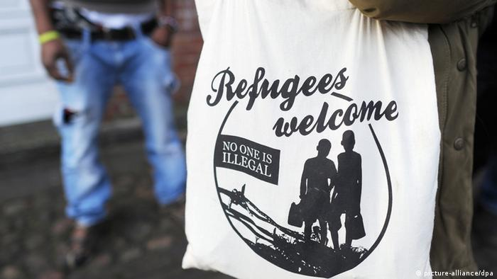 A textile bag with the slogan 'Refugees welcome' printed on it