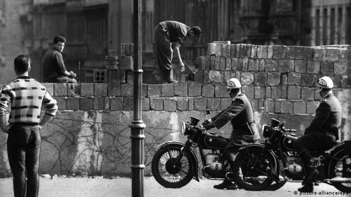 Construction on a wall that would divide families and a nation began in 1961, despite East German 'intentions'...