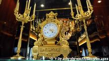 A view of a clock and candelabra inside the Mezhygirya, the luxury residence of former Ukrainian President Viktor Yanukovych, not far from Kiev on February 24, 2014. Ukraine issued an arrest warrant on February 24 for ousted president Viktor Yanukovych over the 'mass murder' of protesters and appealed for $35 billion in Western aid to pull the crisis-hit country from the brink of economic collapse. The dramatic announcements by the ex-Soviet nation's new Western-leaning team -- approved by parliament over a chaotic weekend that saw the pro-Russian leader go into hiding -- came as a top EU envoy arrived in Kiev to buttress its sudden tilt away from Moscow. AFP PHOTO / YURIY DYACHYSHYN (Photo credit should read YURIY DYACHYSHYN/AFP/Getty Images)