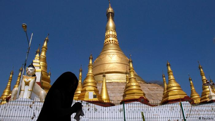 Man walks around the Kyaik Khuauk Pagoda in Thanlyin, south of Yangon February 22, 2014.