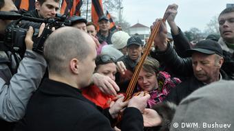 Pro-Russian residents of Sevastopol wear the St. George's Ribbon