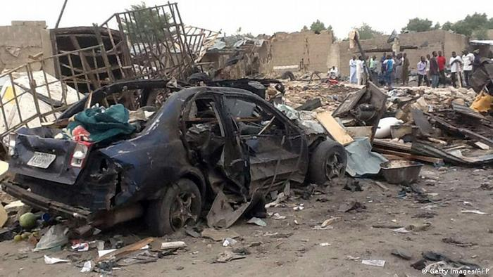 A destroyed car and pile of rubble left from a bomb attack. Photo: STRINGER/AFP/Getty Images