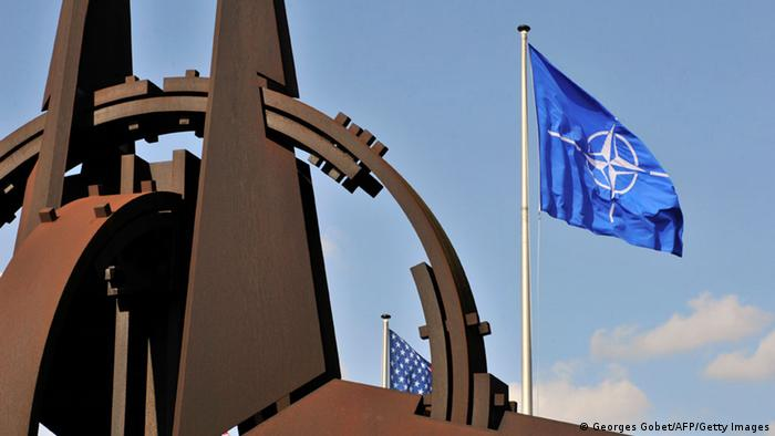 The NATO flag flies at NATO headquarters in Brussels
