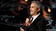 Alfonso Cuaron accepts the Oscar for best director for Gravity at the 86th Academy Awards in Hollywood, California March 2, 2014. REUTERS/Lucy Nicholson (UNITED STATES - Tags: ENTERTAINMENT) (OSCARS-SHOW)