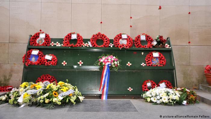 A picture of a memorial to the First World War in Belgium with wreaths laid out to remember the dead.