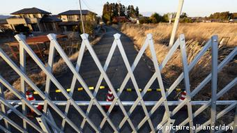 A barricade blocks a road in a no-go zone in Namie, Fukushima Prefecture, in January 2014, almost three years after the March 11, 2011, earthquake and tsunami disaster that triggered meltdowns at the Fukushima Daiichi nuclear power plant.