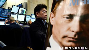 trader and picture of putin
