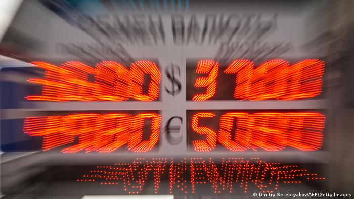A board listing foreign currency rates against the Russian ruble