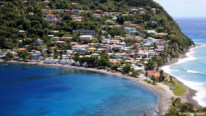 A view over a bay surrounded by houses in Dominica
