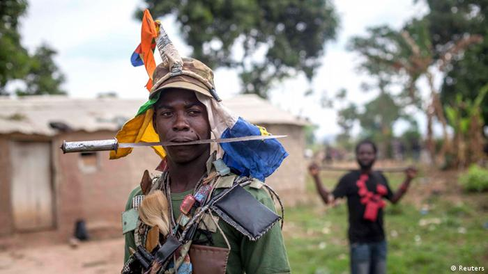 An anti-balaka fighter from the CAR armed with a machete and wearing charms