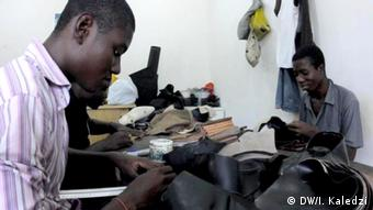 Horseman workers stitching shoes