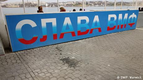 A billboard common in Crimea reading glory to the naval battle fleet. The sign is in blue with the white, blue and red from the Russian tricolor.