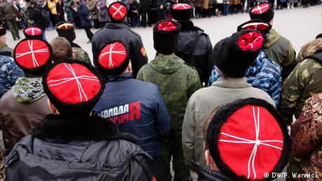 A picture of the traditional Kubanka wool hats which some Cossacks wear. They are white cross on a red background.