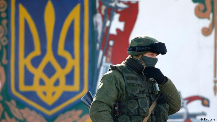 A Russian soldier looks off-camera Photo: REUTERS/Vasily Fedosenko