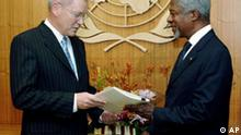 U.N. investigator Detlev Mehlis, left, hands U.N. Secretary General Kofi Annan the report on the assassination of former Lebanese Premier Rafik Hariri during a meeting in Annan's office at the United Nations headquarters, Thursday Oct. 20, 2005. Many in Lebanon and elsewhere blame Syria for the Feb. 14 assassination of Hariri whose motorcade was bombed on a Beirut street, killing him and 20 others. ( AP Photo/Henny Ray Abrams)