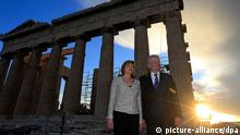 epa04111057 German President Joachim Gauck (R) and his partner Daniela Schadt (L) pose for photographers in front of the Parthenon temple during their visit on Acropolis hill in Athens, Greece, 05 March 2014, Joachim Gauck is in Greece on a three-days official visit. EPA/ORESTIS PANAGIOTOU
