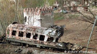 Damaged rail wagon in Kosovo
