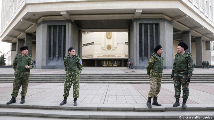 Pro-Russian activists believed to be Cossaks guard Crimea's parliment building in Simferopol.