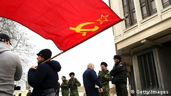 Russian soldiers waving a flag in Crimea