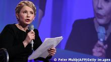 Yulia Tymoshenko, leader of Ukraine's Batkivshchyna Party, addresses delegates at the Dublin Convention Centre in Dublin, Ireland, on March 6, 2014. Up to 2,000 delegates arrive in Dublin Thursday for the start of the European Peoples Party (EPP) conference, where the party will vote for its preferred candidate to succeed Jose Manuel Barroso as President of the European Commission. AFP PHOTO / PETER MUHLY (Photo credit should read PETER MUHLY/AFP/Getty Images)