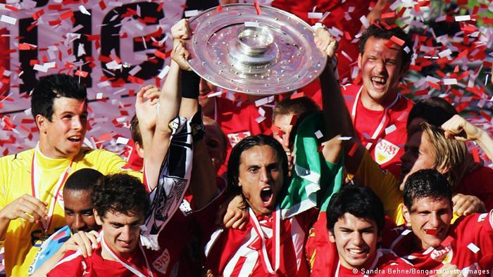 VfB Stuttgart players hold aloft the Bundesliga trophy after winning the championship