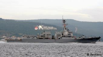 The U.S. Navy guided-missile destroyer USS Truxtun sets sail in the Dardanelles straits, on its way to the Black Sea March