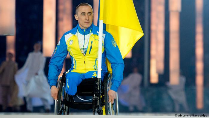 A Ukraine Paralympic athlete holds a Ukraine flag during opening ceremonies in Sochi, Russia.