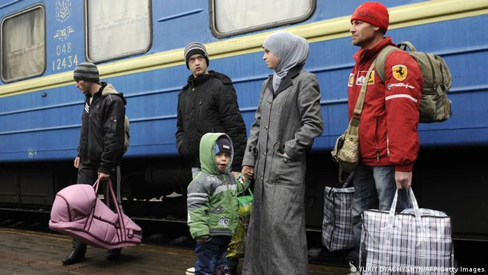 A family of Muslim Crimean Tatars gets off a train in Lviv. They fled from Crimea. (Photo: YURIY DYACHYSHYN/AFP/Getty Images)